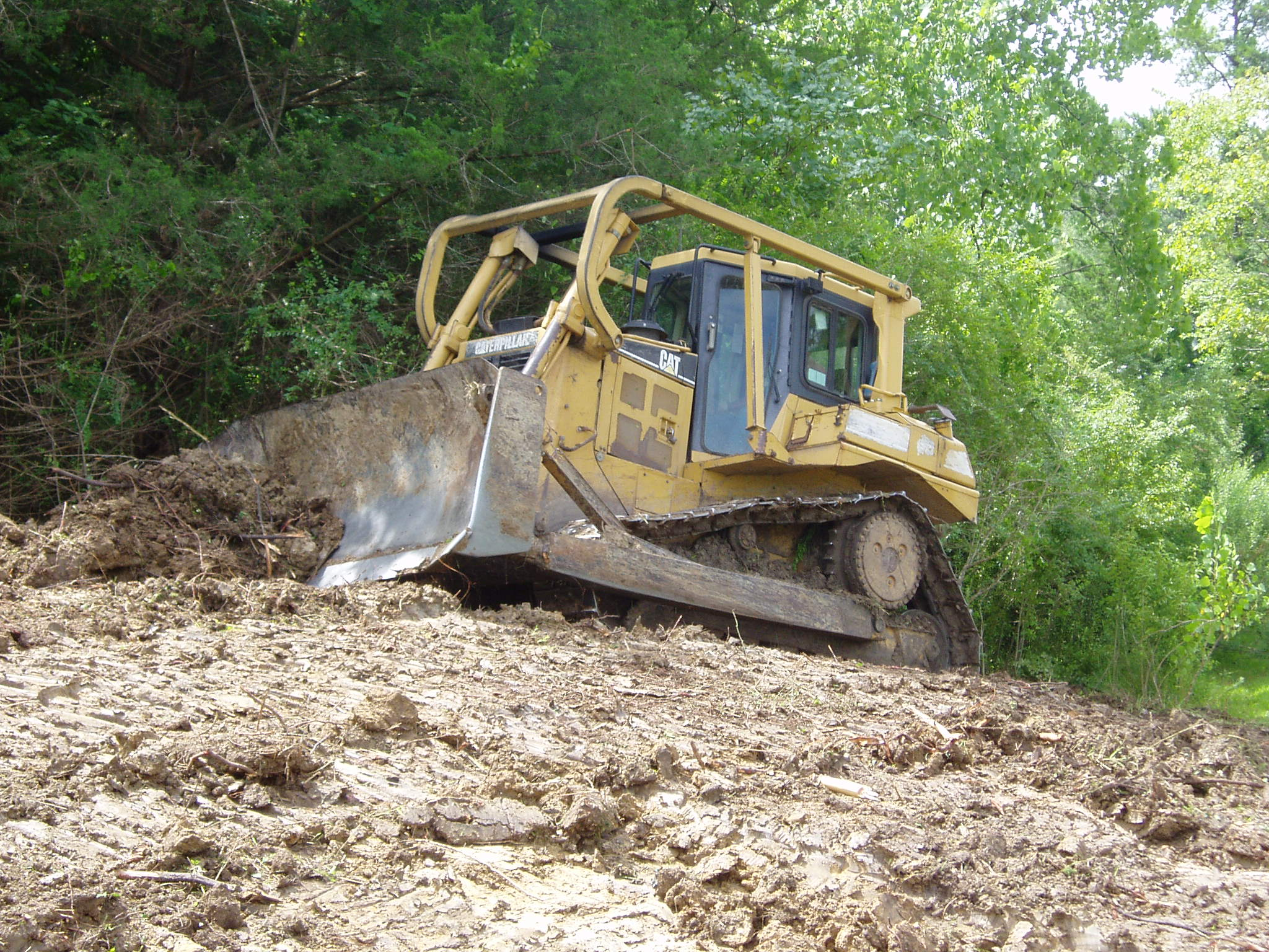 how to clear land with a dozer